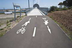 Pedestrian Bicycle bridge busy road Royalty Free Stock Images