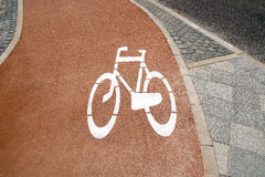 The safe way  for bikes. Bicycle road sign painted on the pavement Stock Photos