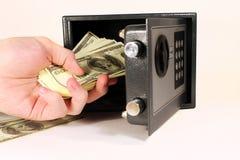 Safebox con el dinero Imagen de archivo libre de regalías