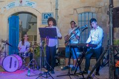 Klezmer Festival 2018 in Safed Tzfat. Safed, Israel - August 14, 2018: Scene of the Klezmer Festival, with street musicians playing, in Safed Tzfat, Israel. Its stock images