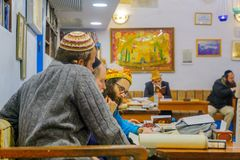 Purim 2018 in the old Abuhav synagogue, Safed Tzfat. SAFED, ISRAEL - FEB 28, 2018: Traditional Purim Jewish Holiday in the old Abuhav synagogue with prayers Stock Image