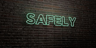 SAFELY -Realistic Neon Sign on Brick Wall background - 3D rendered royalty free stock image Stock Photos