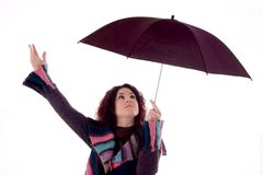 Safety. Beautiful woman with umbrella over white background Royalty Free Stock Photos