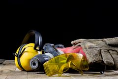 Safety accessories and impact hammer. Accessories for a builder royalty free stock photos