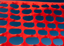 Safety barrier lattice pattern orange and blue sky Royalty Free Stock Photos