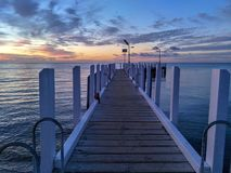 Sunset over jetty / sunset over pier royalty free stock images