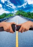 Safety belt. Close up two hand use safety belt on street background Stock Image