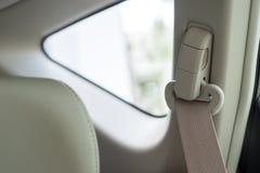 Safety belt on white car Royalty Free Stock Image