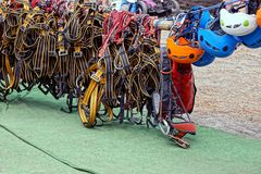Safety belts and helmets on the rope in the amusement park Royalty Free Stock Photography