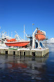 Safety boat and icy sea Royalty Free Stock Photos