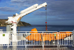 Safety boat lift on a ship Stock Photo