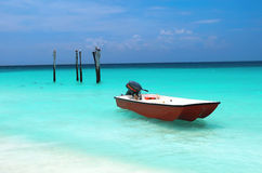 Safety boat on the paradise water. Royalty Free Stock Photos