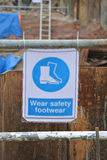 Safety boots sign at the construction site Stock Photo