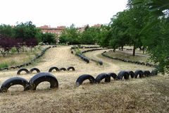 Safety borders on a go-cart track made of old rubber tires embedded in the ground.  royalty free stock photos