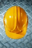 Safety building helmet on grooved metal sheet.  stock photography