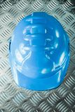 Safety building helmet on grooved metal sheet.  stock photos