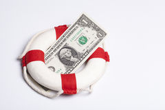 Safety buoy with dollar Royalty Free Stock Image