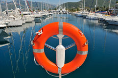 Safety buoy in marina. Safety buoy with big marina in the background Royalty Free Stock Photos