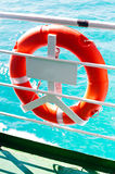 Safety buoy. At tourist cruise boat with blue ocean background Royalty Free Stock Images