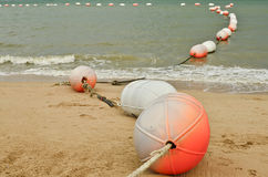 Safety buoys. On a beach Royalty Free Stock Image
