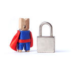 Safety business, safeness concept. Locked padlock. Safeguard clothespin superhero in blue, red suit and metal lock on white background. copy space Stock Photo