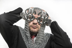 Safety, businessman with medieval executioner in metal and silve Stock Photo