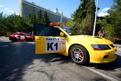 Safety Car on IRC PRIME Yalta Rally 2012. Yalta, UKRAINE - SEPTEMBER 14: Red and Yellow Safety Car on the road IRC PRIME Yalta Rally 2012 Stock Image