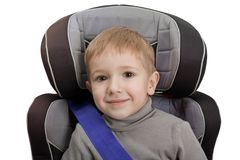Safety car seat. Little child on vehicle car safety seat with belt Stock Image