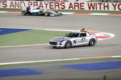 Safety car on track during yellow flag on accident Stock Photography