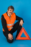 Safety check. A man with safety vest Royalty Free Stock Photos