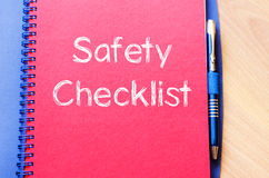 Safety checklist write on notebook Royalty Free Stock Photos