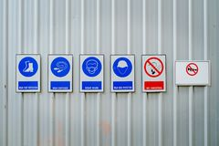 Safety clothing or personal protective equipment and prohibition. Signs in hazardous areas of work site for industrial concept royalty free stock image