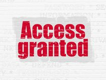 Safety concept: Access Granted on wall background. Safety concept: Painted red text Access Granted on White Brick wall background with  Tag Cloud Royalty Free Stock Photo