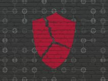 Safety concept: Broken Shield on wall background. Safety concept: Painted red Broken Shield icon on Black Brick wall background with Scheme Of Binary Code Royalty Free Stock Images