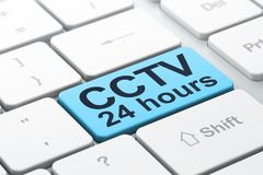 Safety concept: CCTV 24 hours on computer keyboard background Royalty Free Stock Photos