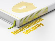 Safety concept: book Shield With Keyhole, International Security on white background Stock Photos