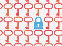 Safety concept: closed padlock icon on wall. Safety concept: rows of Painted red key icons around blue closed padlock icon on White Brick wall background, 3d Royalty Free Stock Photo