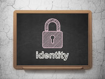 Safety concept: Closed Padlock and Identity on chalkboard background Stock Photos