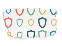 Safety concept: Contoured Shield icons on Torn Royalty Free Stock Images