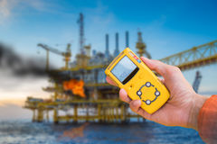 Safety concept of fire in oil and gas, petrochemical industry, gas detector checking gas leaking. Safety concept of fire in oil and gas, petrochemical industry Stock Photography