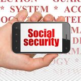 Safety concept: Hand Holding Smartphone with Social Security on display Royalty Free Stock Photo