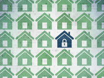 Safety concept: home icon on Digital Paper. Safety concept: rows of Painted green home icons around blue home icon on Digital Paper background, 3d render Royalty Free Stock Photo