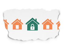 Safety concept: home icon on Torn Paper background. Safety concept: row of Painted orange home icons around green home icon on Torn Paper background Royalty Free Stock Image