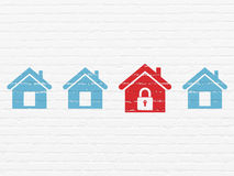 Safety concept: home icon on wall background Royalty Free Stock Photography