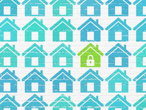 Safety concept: home icon on wall background. Safety concept: rows of Painted blue home icons around green home icon on White Brick wall background, 3d render Royalty Free Stock Image