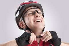 Safety Concept and Ideas. Male Caucasian Cyclist Checking Road Helmet. Wearing Glasses. Stock Images