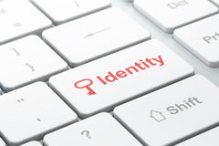 Safety concept: Key and Identity on computer Royalty Free Stock Image
