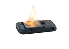 Safety concept- Mobile phone battery explodes and burns due to overheat on white background Stock Photo
