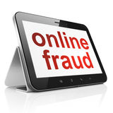 Safety concept: Online Fraud on tablet pc computer. Safety concept: black tablet pc computer with text Online Fraud on display. Modern portable touch pad on Royalty Free Stock Images