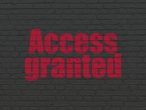 Safety concept: Access Granted on wall background. Safety concept: Painted red text Access Granted on Black Brick wall background Royalty Free Stock Photos
